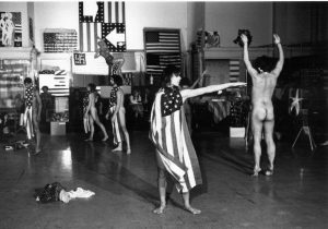 Estate of Peter Moore - Trio A with Flags by Yvonne Rainer - 1970/2019